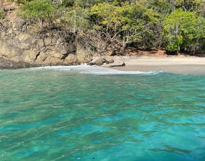 Beach in Costa Rica with beautiful blue water