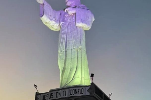 Beautiful view of the Christ of Mercy at sunset