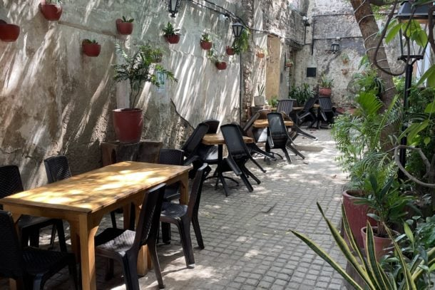 Outside seating area with seats and tables at Di Silvio Italian Restaurant in Cartagena, Columbia