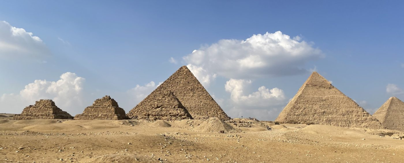 ancient Egyptian pyramids and sunny blue skies