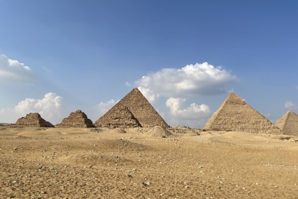 Ancient Egyptian pyramids and sunny blue skies in the sandy desert of Egypt