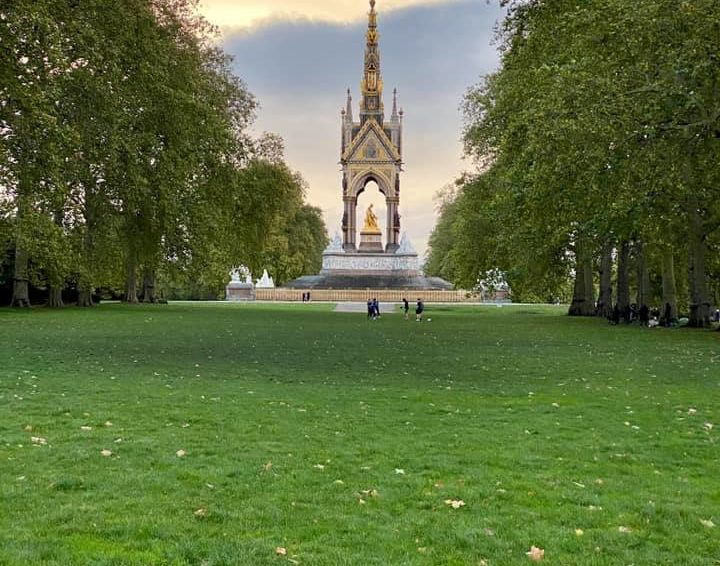 The Albert Memorial in Kensington Garden surrounded by green lawns and manicured trees in London, England, UK