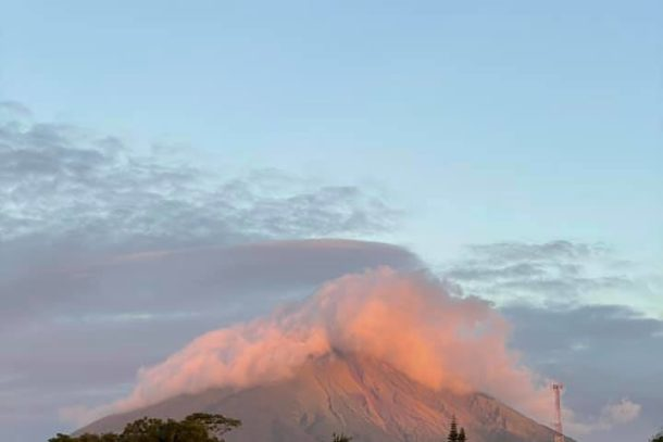 Distant view of smoking Masaya Volcano with a beautiful sky behind it in Nicaragua