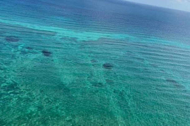 Incredible view of the turquoise waters from a helicopter in Cancun, Mexico
