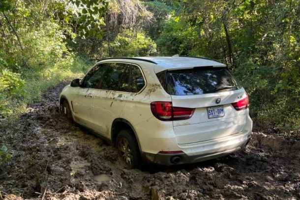 white BMW SUV stuck in the mud in a Palo Verde National Park, Costa Rica