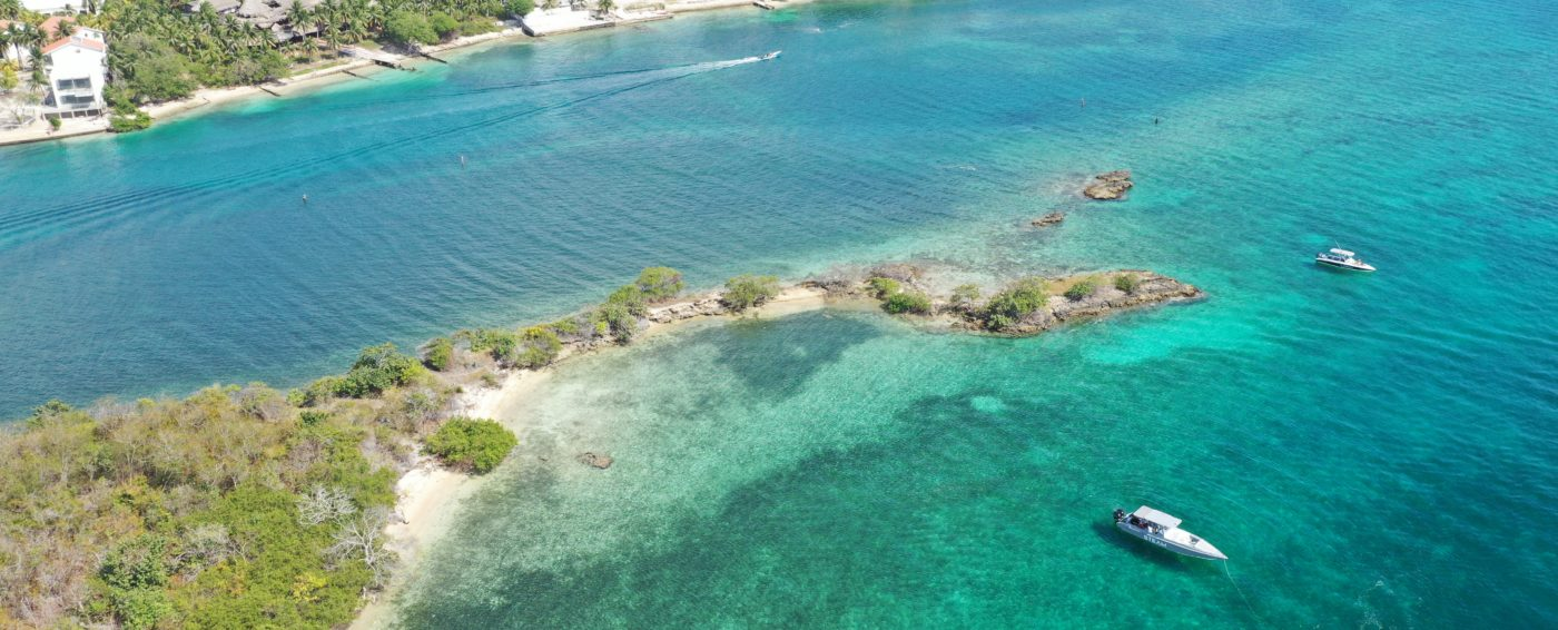 aerial view of beautiful island with clear water