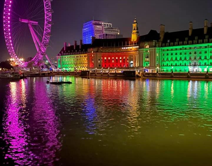 The Thames River at night in front of The London Eye in London, England, United Kingdom