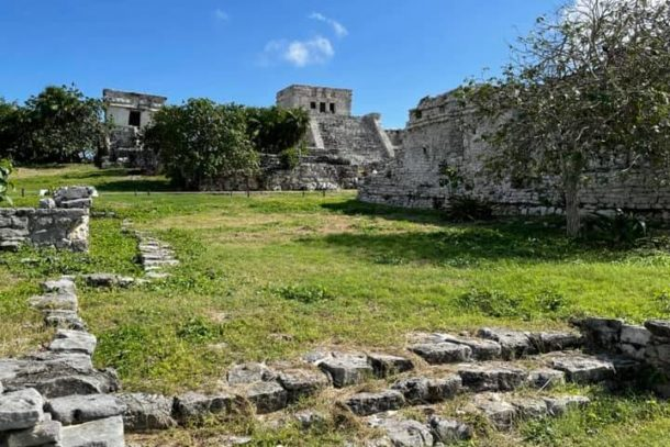 Distant view of El Castillo and surrounding Mayan ruins in Tulum, Mexico