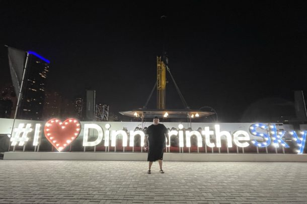 Lit up sign of the Dinner in the Sky attraction in Dubai