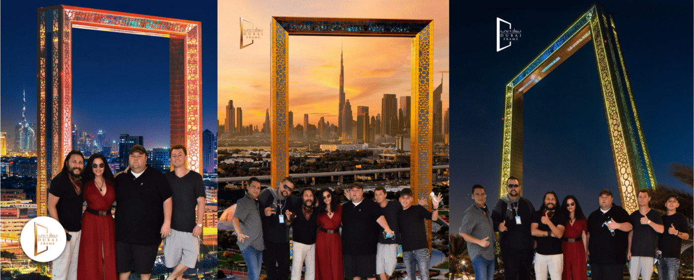 Group of friends standing in front of a giant gold frame that frames the city skyline in dubai