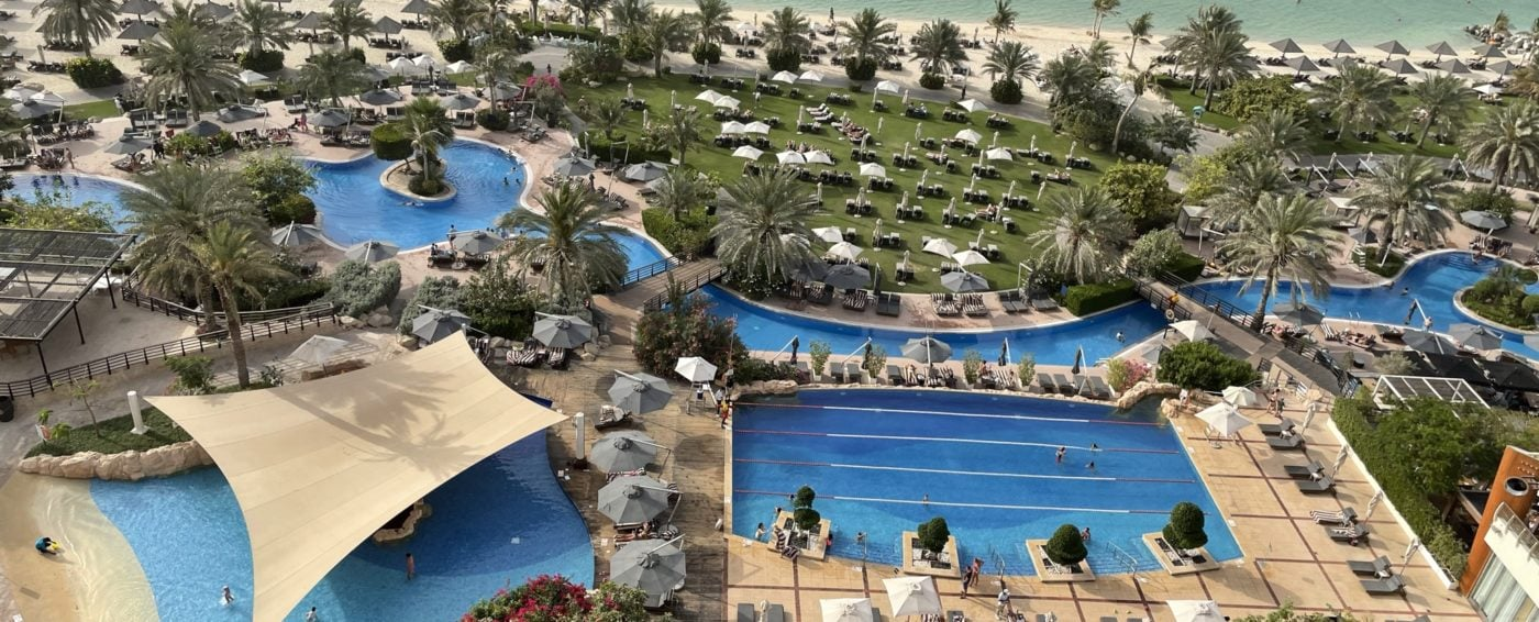 View of the beautiful pools and Arabian Gulf from our balcony at the Westin Resort