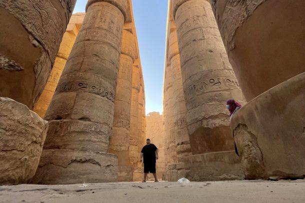 Standing in between the huge columns in the Temple of Karnak in Luxor