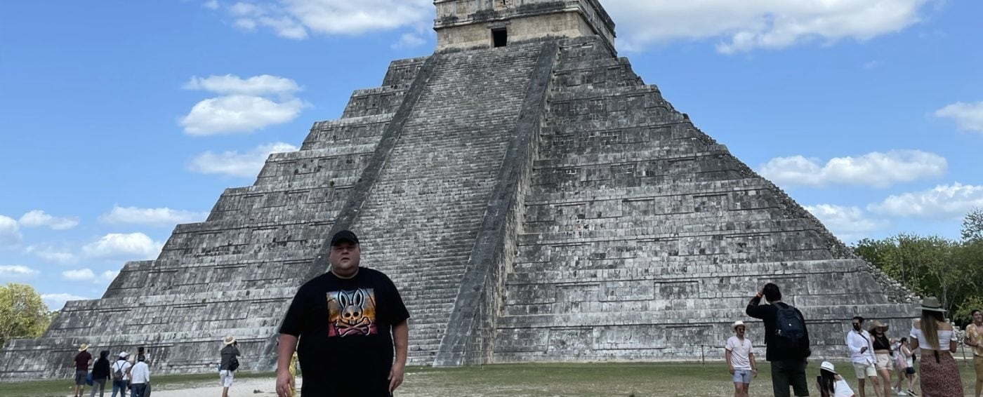 Standing in front of the ancient Mayan temple El Castillo in Chichen Itza located in Mexico