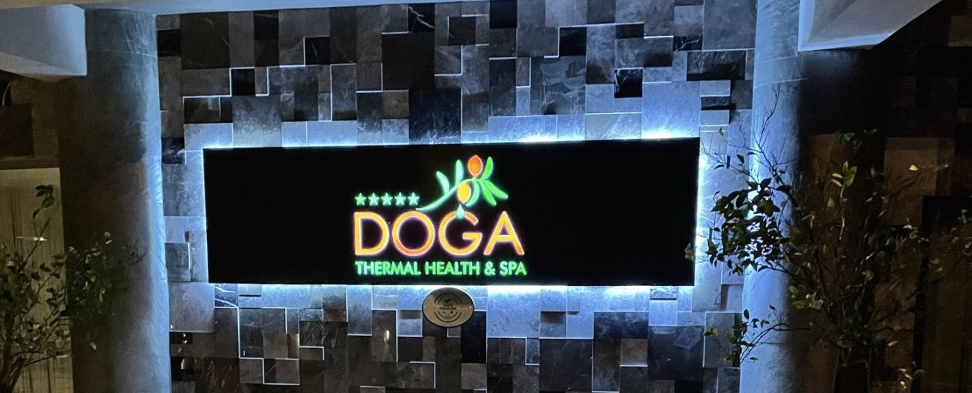 Lit up sign of the Doga Hotel in Turkey