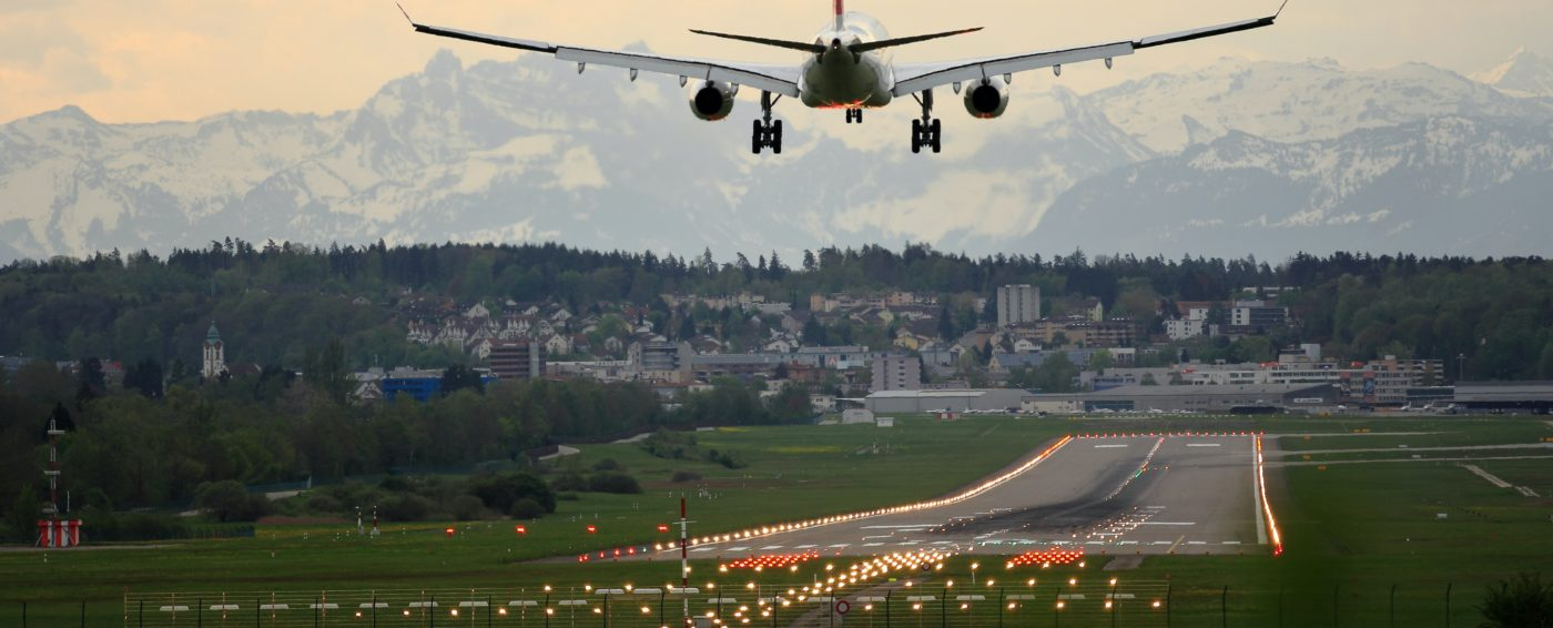 airplane landing with scenic background