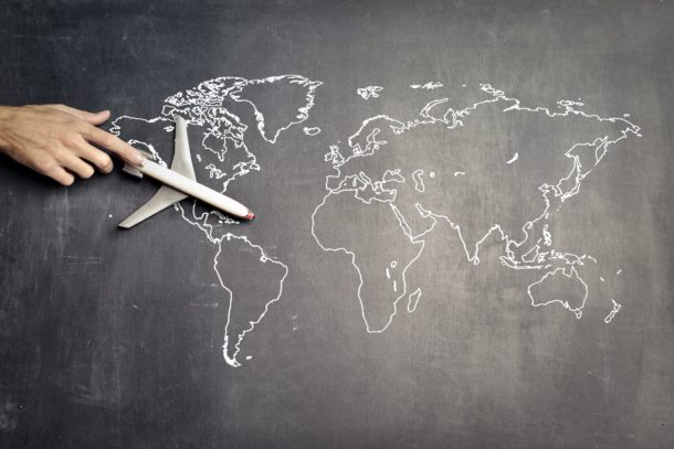 Toy airplane on a chalkboard map