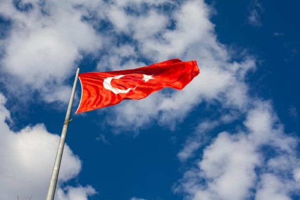 Bright red flag of Turkey blowing in the wind