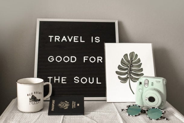 Travel is good for the soul picture with camera and coffee mug