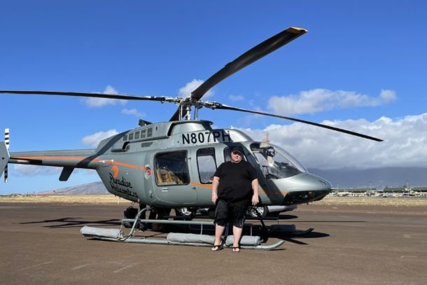 Mark standing in front of a helicopter in Hawaii