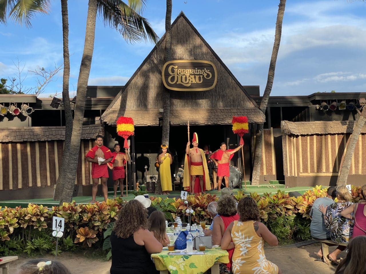 A group watches a luau in Hawaii